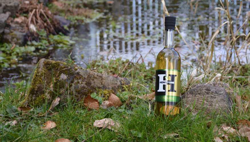 Nonpareil bottle next to water