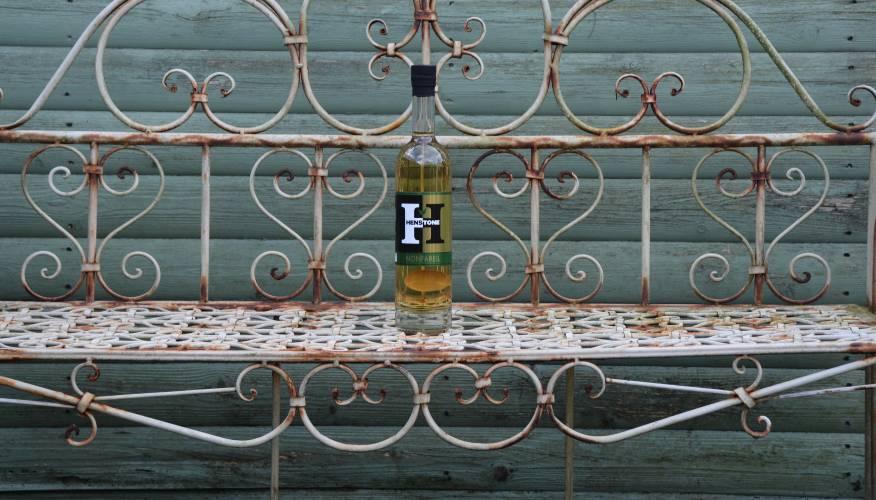 Nonpareil bottle on garden bench
